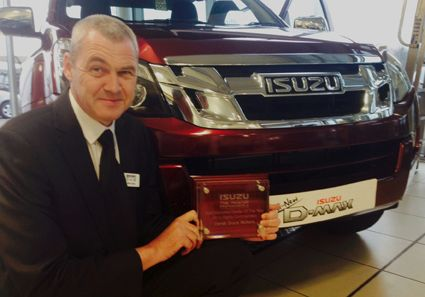 Derek Slack Motors receive Isuzu award.